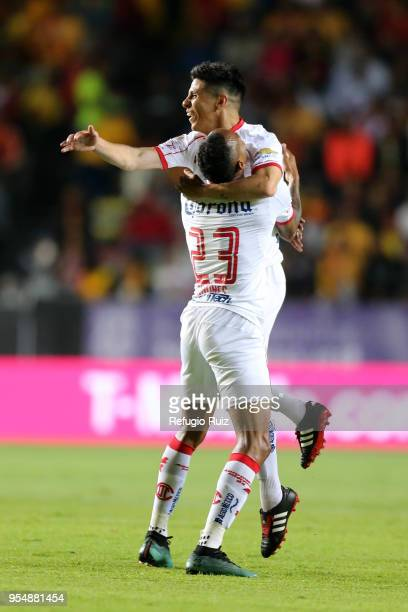 Pablo Barrientos of Toluca celebrates with teammates after scoring the first goal of his team during the quarter finals first leg match between...