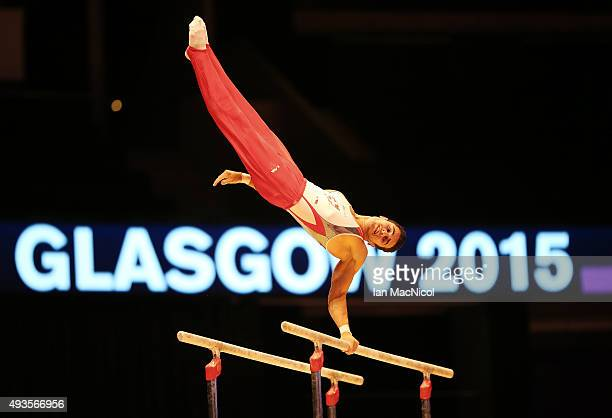 Pablo Braga of Switzerland practises on the Parallel Bars during the 2015 World Artistic Gymnastics Championships Media Session at The SSE Hydro on...