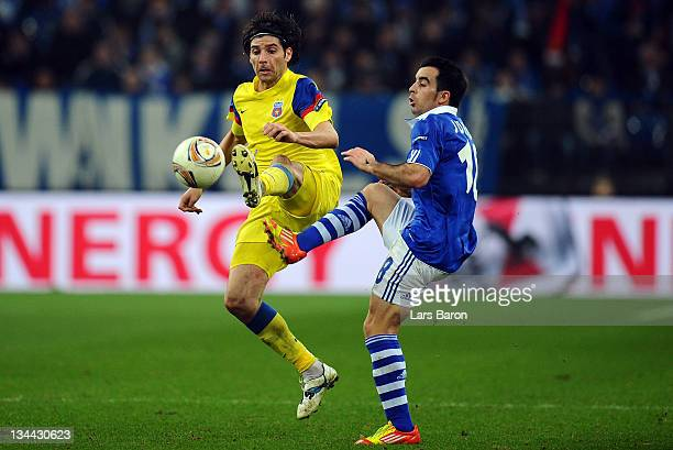 Pablo Brandan of Steaua is challenged by Jose Manuel Jurado of Schalke during the UEFA Europa League group J match between FC Schalke 04 and FC...