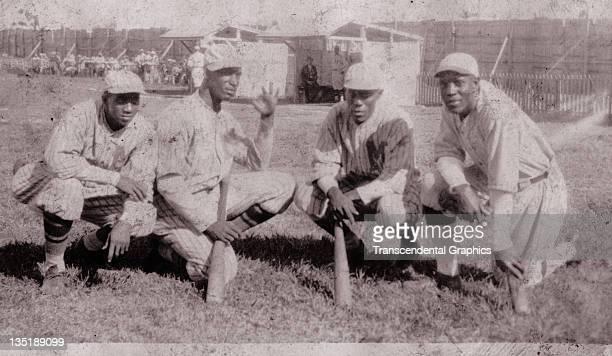 Pablo 'Campeon' Mesa, Martin Dihigo, Alejandro Oms, and Pelayo Chacon, a group of Cuban Hall of Fame baseball stars pose together in Havana, Cuba...