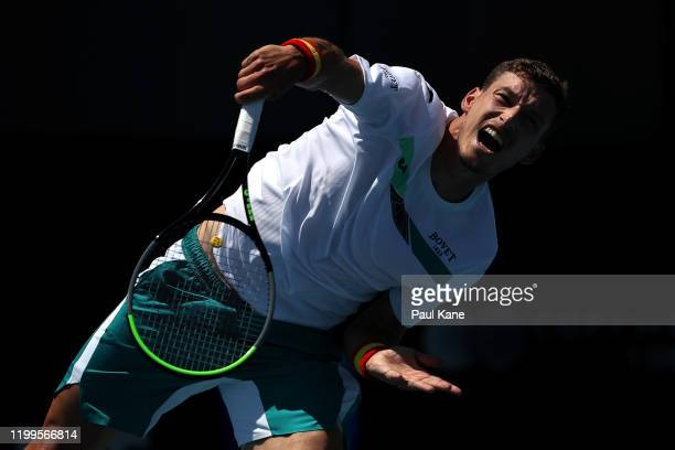 Pablo Carrena Busta of Spain serves to Jeremy Chardy of France during day four of the 2020 Adelaide International at Memorial Drive on January 15...