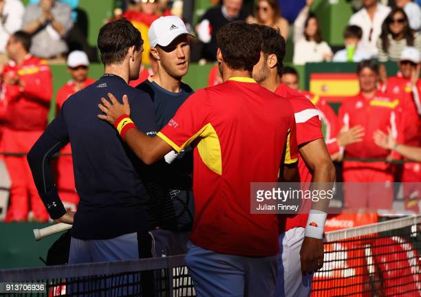 Pablo Carreno Busta and Feliciano Lopez of Spain are congratulated by Dom Inglot and Jamie Murray of Great Britain after their straight sets win in...