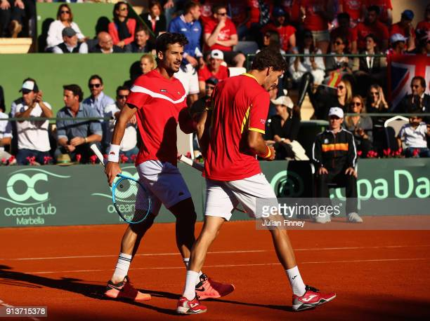 Pablo Carreno Busta and Feliciano Lopez of Spain celebrate a point against Dom Inglot and Jamie Murray of Great Britain in the doubles during day two...