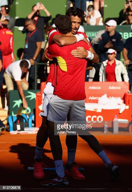 Pablo Carreno Busta and Feliciano Lopez of Spain celebrate defeating Dom Inglot and Jamie Murray of Great Britain in the doubles during day two of...