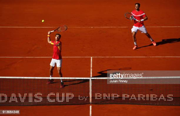 Pablo Carreno Busta and Feliciano Lopez of Spain in action against Dom Inglot and Jamie Murray of Great Britain in the doubles during day two of the...