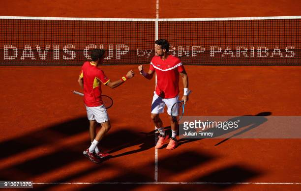 Pablo Carreno Busta and Feliciano Lopez of Spain take the first set against Dom Inglot and Jamie Murray of Great Britain in the doubles during day...