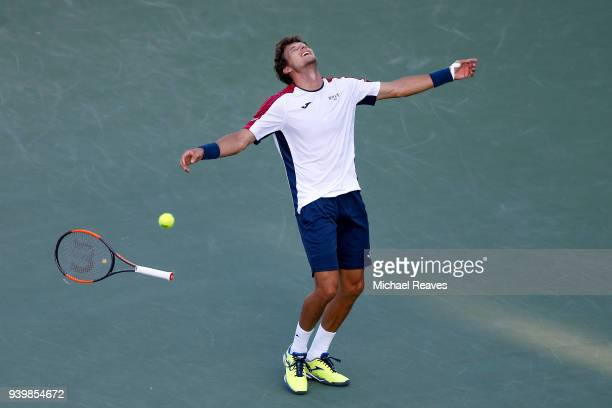 Pablo Carreno Busta celebrates match point against Kevin Anderson during their quarterfinal match on Day 11 of the Miami Open Presented by Itau at...