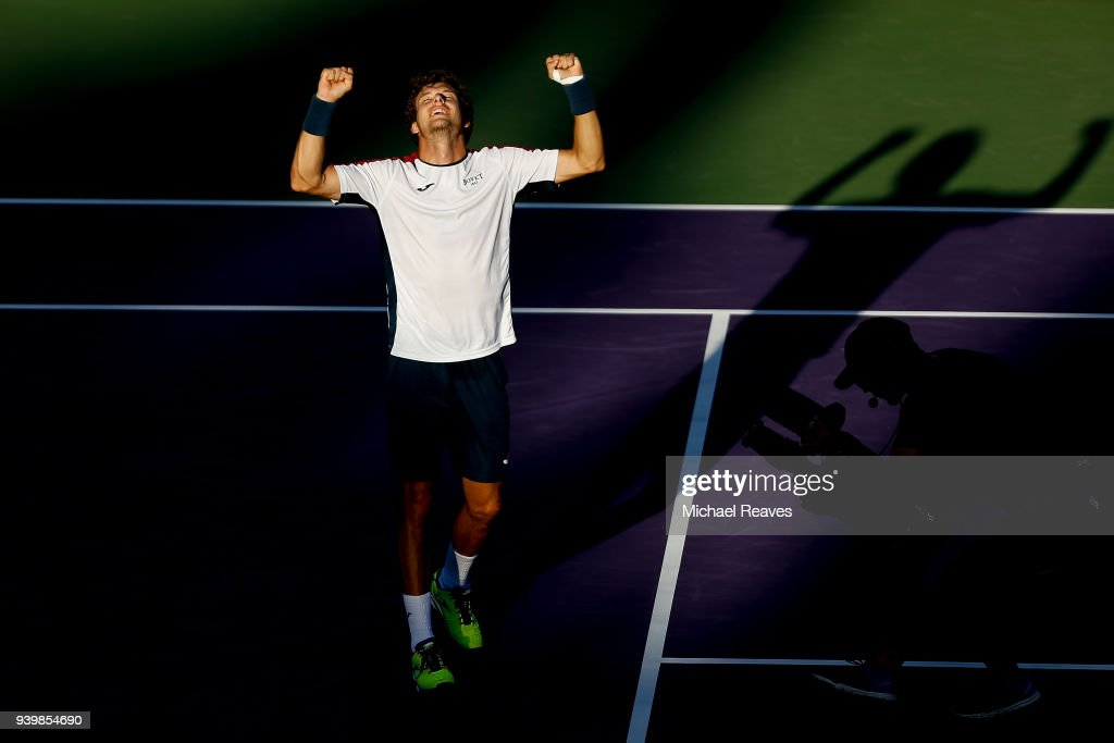 Pablo Carreno Busta celebrates match point against Kevin Anderson during their quarterfinal match on Day 11 of the Miami Open Presented by Itau at Crandon Park Tennis Center on March 29, 2018 in Key Biscayne, Florida.