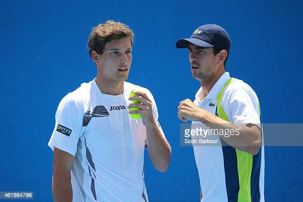 Pablo Carreno Busta of Spain and Guillermo Garcia-Lopez of Spain talk tactics in their second round doubles match against Aisam-Ul-Haq Qureshi of...