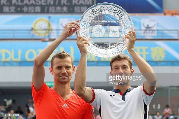 Pablo Carreno Busta of Spain and Mariusz Fyrstenberg of Poland with their trophy after the doubles final match against Raven Klaasen of South Africa...
