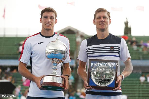 Pablo Carreno Busta of Spain and Matt Ebden of Australia pose for a photo with their trophies after Pablo Carreno Busta wins the Men's Singles Final...