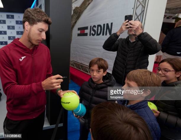 Pablo Carreno Busta of Spain attends fans during the Barcelona Open Banc Sabadell 2019 at Real Club de Tennis de Barcelona on April 22 2019 in...
