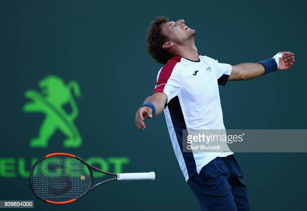 Pablo Carreno Busta of Spain celebrate smatch point against Kevin Anderson of South Africa in their quarterfinal during the Miami Open Presented by...