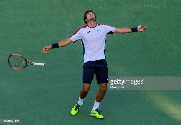Pablo Carreno Busta of Spain celebrates after beating Kevin Anderson of South Africa 64 57 76 during the quarterfinals match on Day 11 of the Miami...