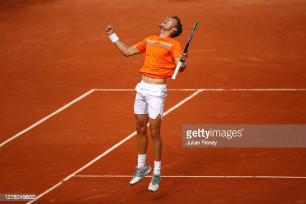 Pablo Carreno Busta of Spain celebrates after winning match point during his Men's Singles third round match against Roberto Bautista Agut of Spain...