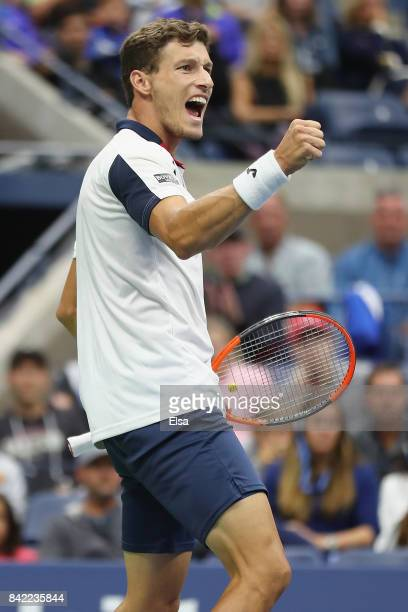 Pablo Carreno Busta of Spain celebrates after winning the second set during his fourth round match against Denis Shapovalov of Canada on Day Seven of...