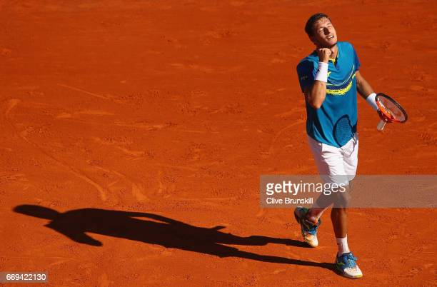 Pablo Carreno Busta of Spain celebrates match point against Fabio Fognini of Italy in their first round match on day two of the Monte Carlo Rolex...