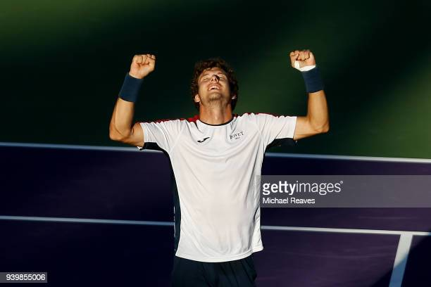 Pablo Carreno Busta of Spain celebrates match point against Kevin Anderson of South Africa during their quarterfinal match on Day 11 of the Miami...