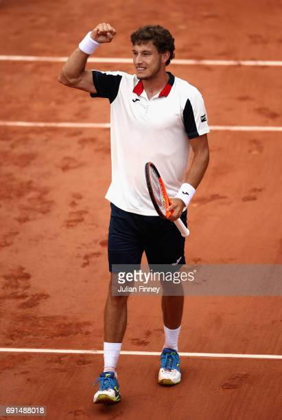 Pablo Carreno Busta of Spain celebrates victory in mens singles third round match against Grigor Dimitrov of Bulgaria on day six of the 2017 French...