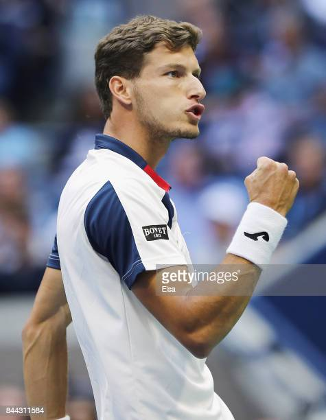 Pablo Carreno Busta of Spain celebrates winning the first set against Kevin Anderson of South Africa during their Men's Singles Semifinal match on...