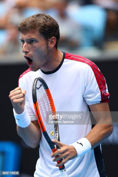 Pablo Carreno Busta of Spain celebrates winning the first set in his fourth round match against Marin Cilic of Croatia on day seven of the 2018...