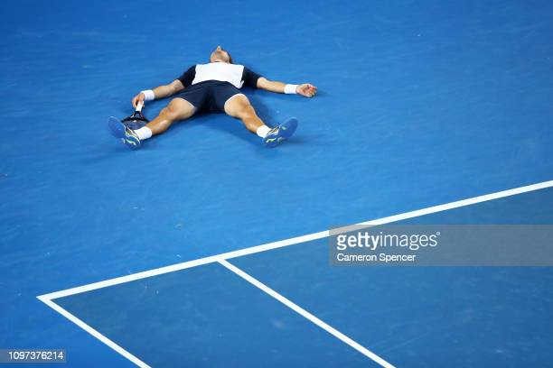 Pablo Carreno Busta of Spain falls to the court after playing a forehand in his fourth round match against Kei Nishikori of Japan during day eight of...