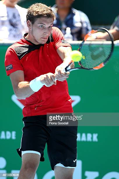 Pablo Carreno Busta of Spain hits a backhand shot in his match against Borna Coric of Croatia during day two of the 2015 Heineken Open Classic at...