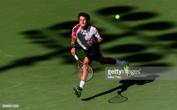 Pablo Carreno Busta of Spain hits a forehand to Kevin Anderson of South Africa during the quarterfinals match on Day 11 of the Miami Open Presented...