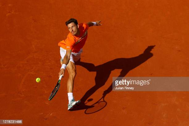Pablo Carreno Busta of Spain plays a backhand during his Men's Singles third round match against Roberto Bautista Agut of Spain on day seven of the...