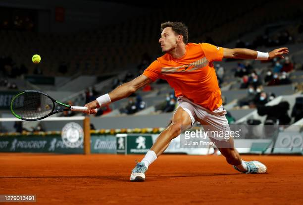 Pablo Carreno Busta of Spain plays a backhand during his Men's Singles quarterfinals match against Novak Djokovic of Serbia on day eleven of the 2020...