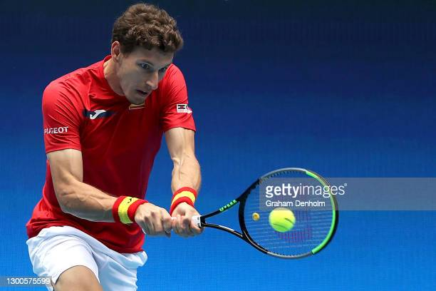 Pablo Carreno Busta of Spain plays a backhand in his match against Fabio Fognini of Italy during day five of the 2021 ATP Cup at John Cain Arena on...