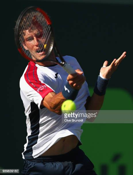 Pablo Carreno Busta of Spain plays a forehand against Kevin Anderson of South Africa in their quarterfinal during the Miami Open Presented by Itau at...