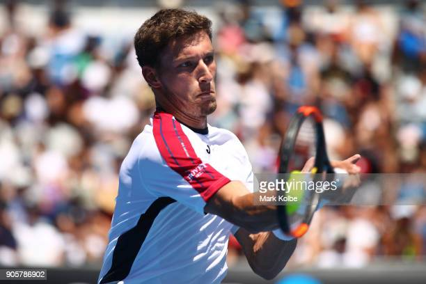 Pablo Carreno Busta of Spain plays a forehand in his second round match against Gilles Simon of France on day three of the 2018 Australian Open at...