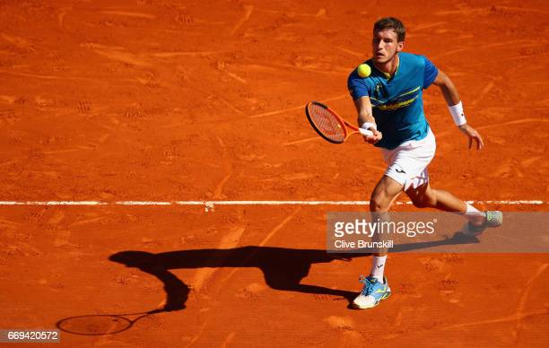 Pablo Carreno Busta of Spain plays a forehand volley against Fabio Fognini of Italy in their first round match on day two of the Monte Carlo Rolex...