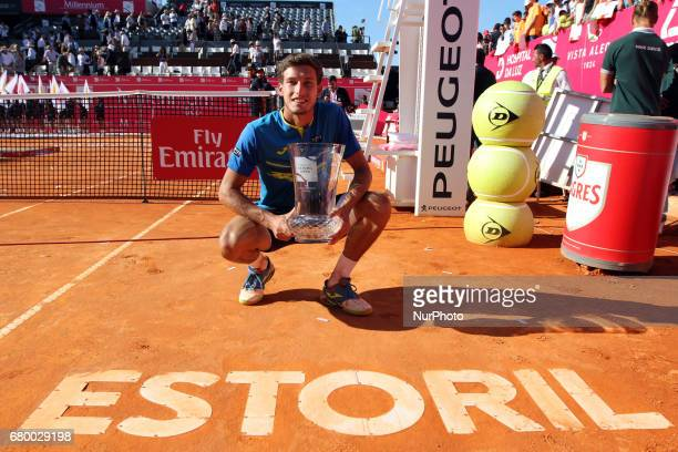 Pablo Carreno Busta of Spain poses with the trophy after winning the Final of the Millennium Estoril Open ATP tennis tournament over Gilles Muller of...