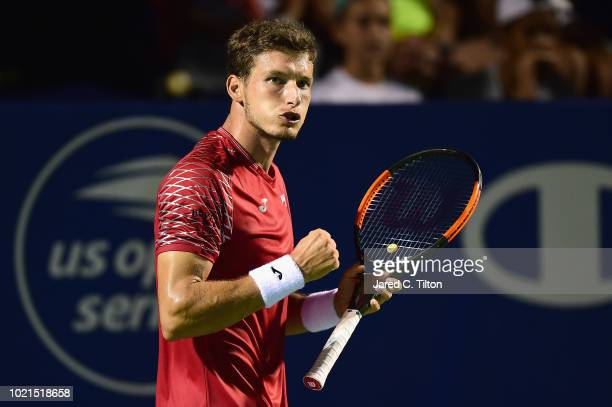 Pablo Carreno Busta of Spain reacts after defeating Peter Gojowczyk of Germany during their match on day three of the WinstonSalem Open at Wake...