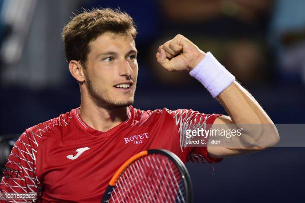 Pablo Carreno Busta of Spain reacts after defeating Peter Gojowczyk of Germany during their match on day three of the Winston-Salem Open at Wake...