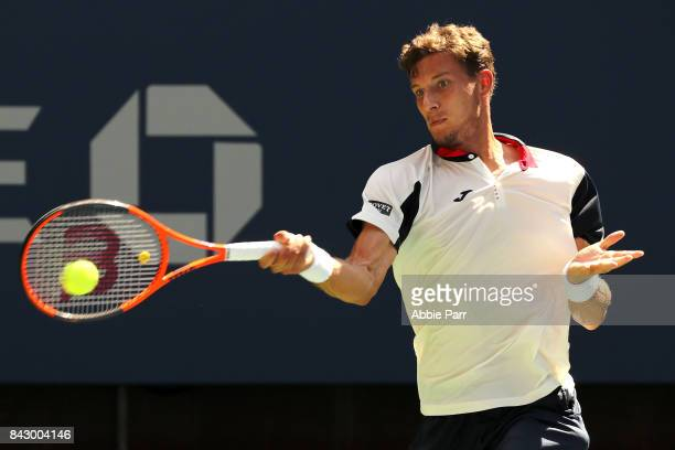 Pablo Carreno Busta of Spain returns a shot against Diego Schwartzman of Argentina during his Men's Singles Quarterfinal match on Day Nine of the...