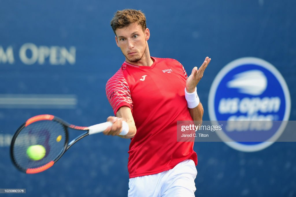 Pablo Carreno Busta of Spain returns a shot from Franko Skugor of Croatia during their match on day two of the Winston-Salem Open at Wake Forest University on August 21, 2018 in Winston-Salem, North Carolina.