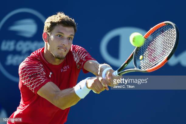 Pablo Carreno Busta of Spain returns a shot from Hyeon Chung of Korea during their quarterfinals match on day four of the WinstonSalem Open at Wake...