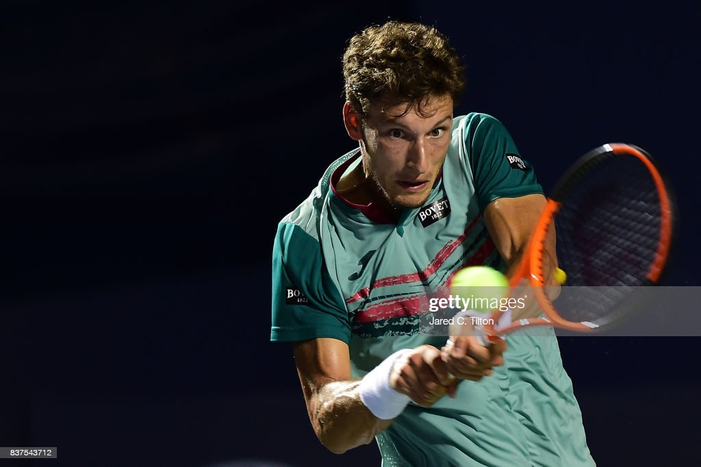 Pablo Carreno Busta of Spain returns a shot from Julien Benneteau of France during the fourth day of the Winston-Salem Open at Wake Forest University on August 22, 2017 in Winston-Salem, North Carolina.