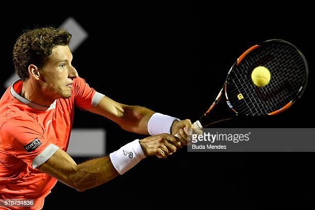 Pablo Carreno Busta of Spain returns a shot to Rafael Nadal of Spain during the Rio Open at Jockey Club Brasileiro on February 16 2016 in Rio de...