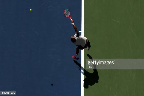 Pablo Carreno Busta of Spain serves against Diego Schwartzman of Argentina during his Men's Singles Quarterfinal match on Day Nine of the 2017 US...