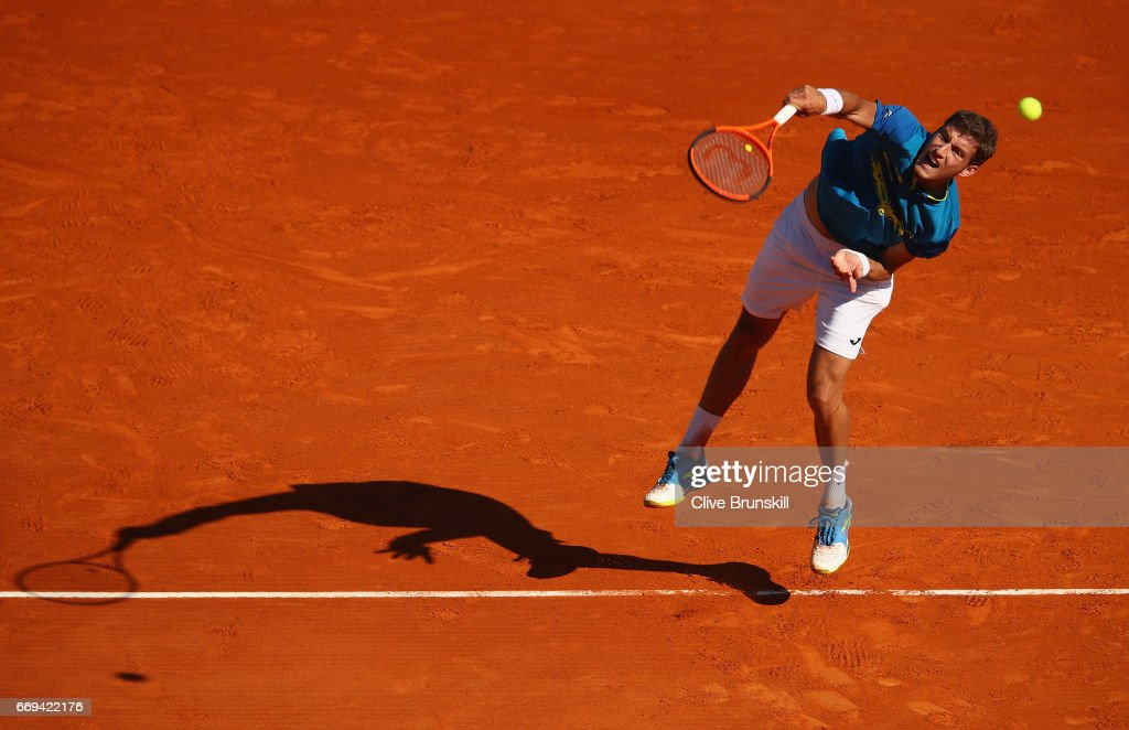 Pablo Carreno Busta of Spain serves against Fabio Fognini of Italy in their first round match on day two of the Monte Carlo Rolex Masters at Monte-Carlo Sporting Club on April 17, 2017 in Monte-Carlo, Monaco.