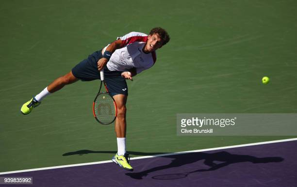 Pablo Carreno Busta of Spain serves against Kevin Anderson of South Africa in their quarterfinal during the Miami Open Presented by Itau at Crandon...
