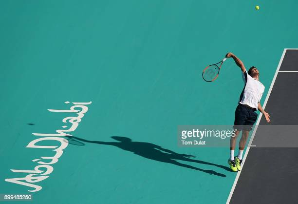 Pablo Carreno Busta of Spain serves during his 5th place play-off match against Andrey Rublev of Russia on day two of the Mubadala World Tennis...