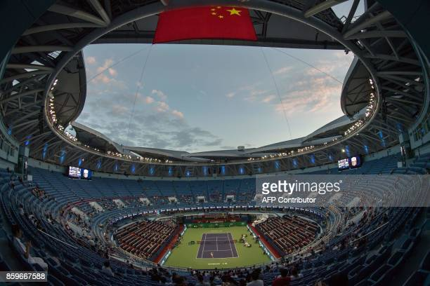 Pablo Carreno Busta of Spain serves during the men's singles against Albert Ramos-Vinolas of Spain at the Shanghai Masters tennis tournament in...