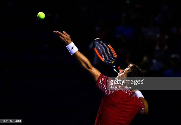 Pablo Carreno Busta of Spain serves to Peter Gojowczyk of Germany during their match on day three of the Winston-Salem Open at Wake Forest University...