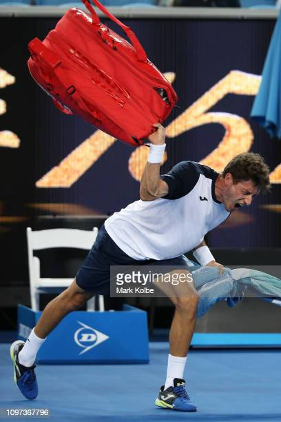 Pablo Carreno Busta of Spain throws his bag as he shows his frustration after defeat in his fourth round match against Kei Nishikori of Japan during...