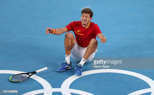 Pablo Carreno Busta of Team Spain celebrates victory after his Men's Singles Bronze Medal match against Novak Djokovic of Team Serbia on day eight of...
